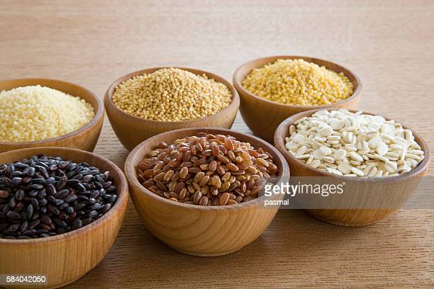 Wooden bowls of different grains