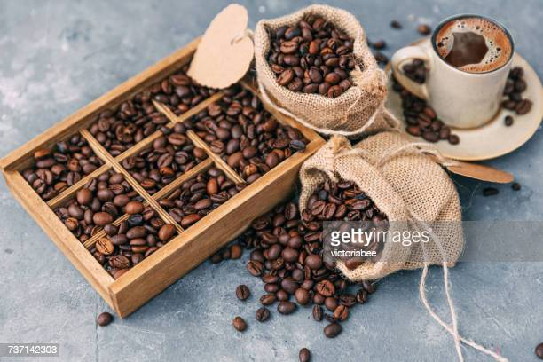 Wooden box and sacks with coffee beans