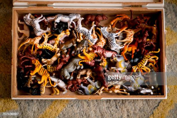 wooden box filled with toy animals - toy box stock pictures, royalty-free photos & images