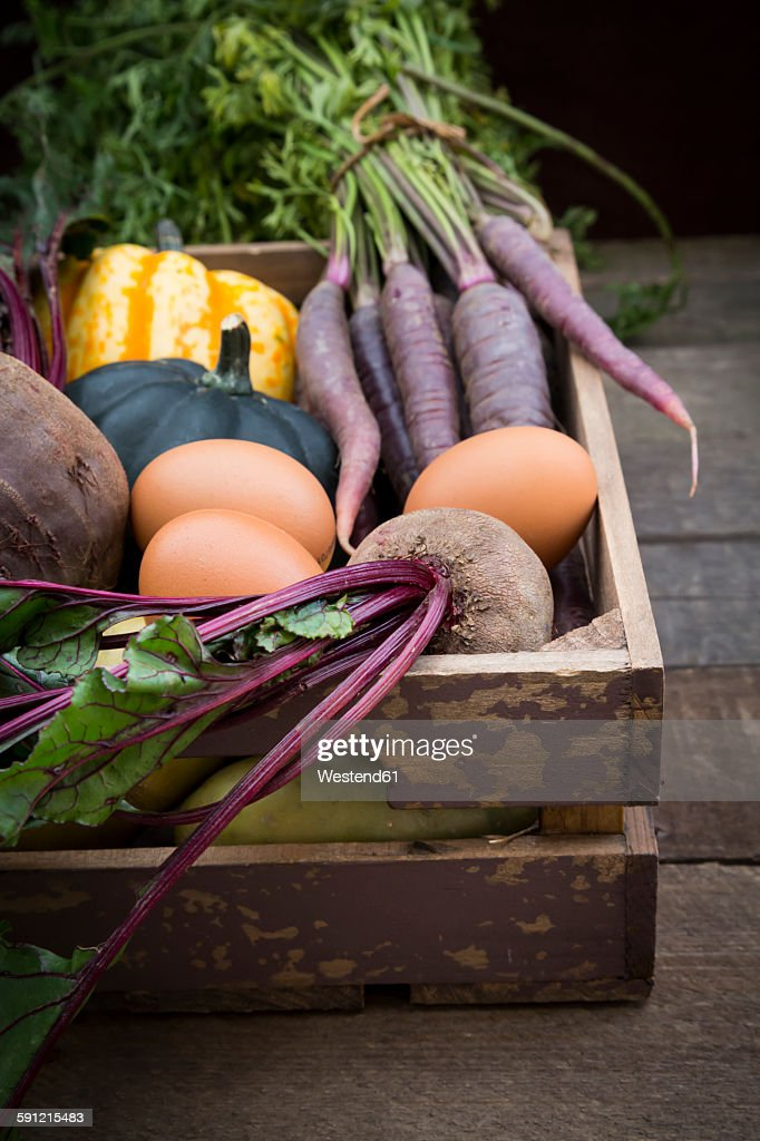 Wooden box of different organic vegetables : Stock Photo