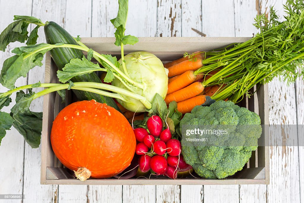 Wooden box of different vegetables : Photo