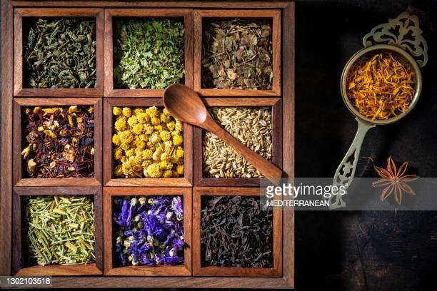 wooden box of tea and herbs including black tea, mallow, chamomile, fennel - infused stock pictures, royalty-free photos & images