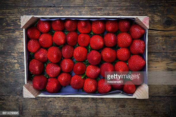 Wooden box with sorted strawberries