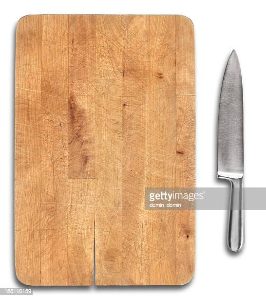 Wooden bread cutting board with stainless steel knife isolated