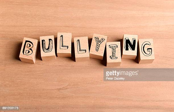 Wooden bricks spelling out word bullying