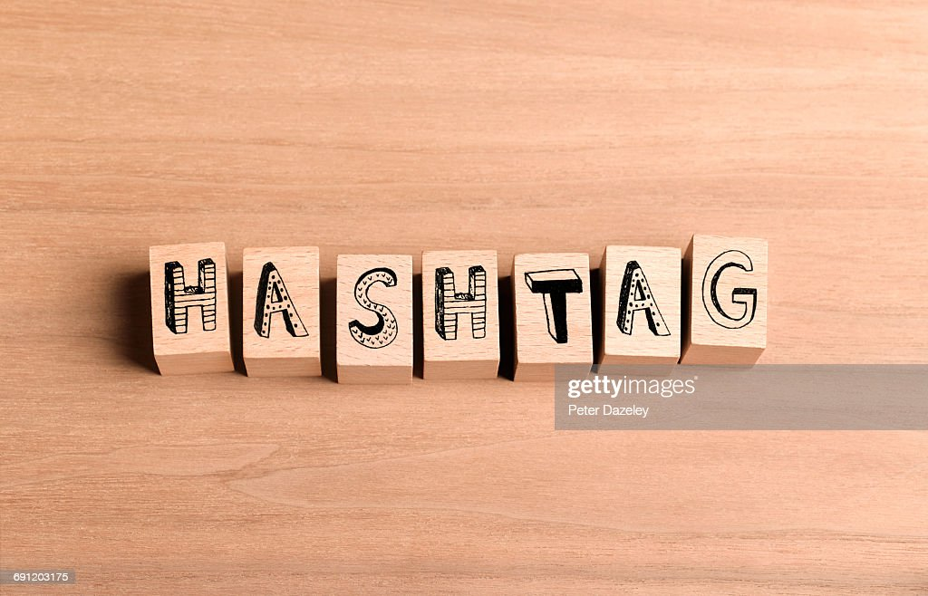 Wooden bricks spelling out word hashtag : Stock Photo