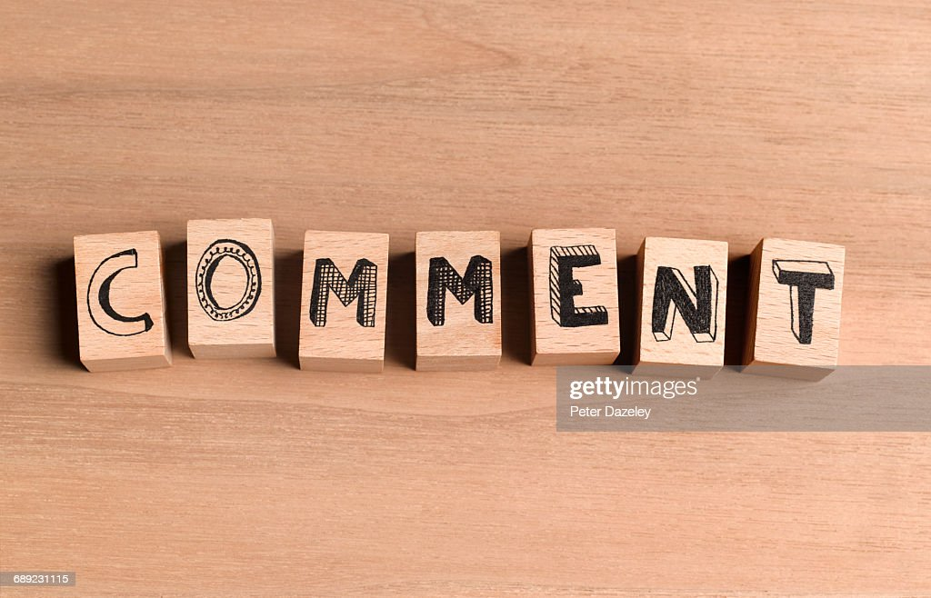 Wooden bricks spelling the word comment : Stock Photo