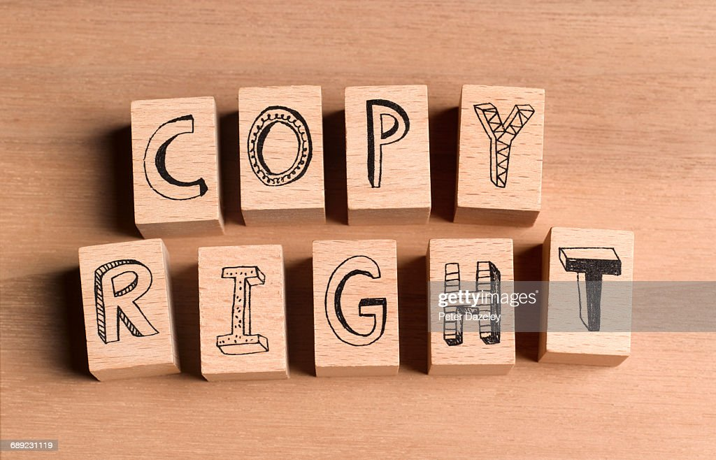 Wooden bricks spelling the word copyright : Stock Photo