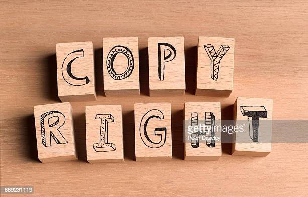 wooden bricks spelling the word copyright - copyright stock photos and pictures