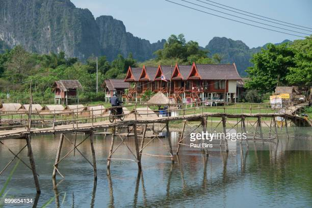 Wooden bridge across Nam Song River in Vang Vieng, Laos