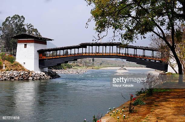 wooden bridge at rinpung dzong, paro, bhutan - paro stock pictures, royalty-free photos & images