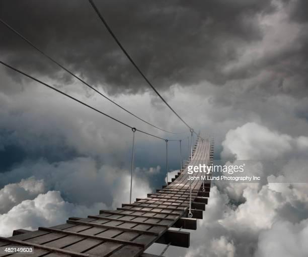 wooden bridge in clouds - footbridge stock photos and pictures