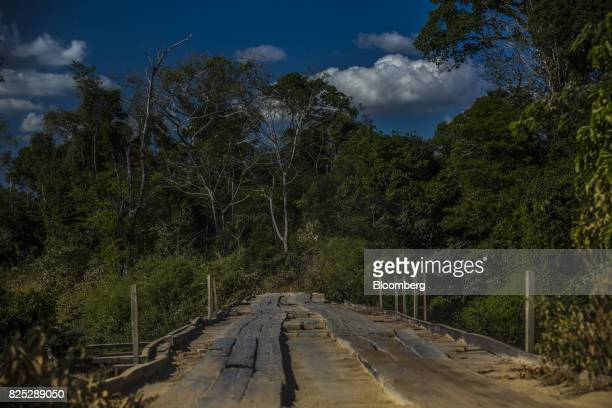 A wooden bridge leads to the Jamanxim National Forest near Novo Progresso Para State Brazil on Thursday July 20 2017 TheBR163highway cuts through...
