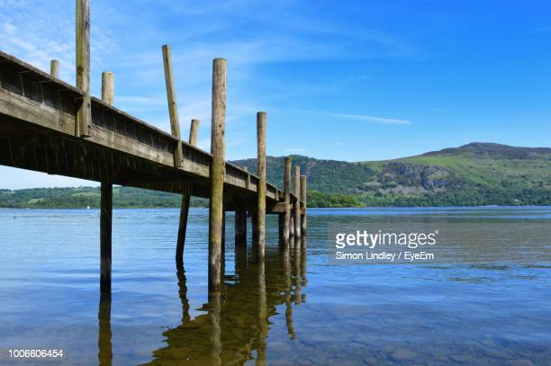 Wooden Bridge Over River Against Sky