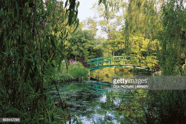 Wooden bridge over the lily pond in the garden of the house of Claude Monet Giverny HauteNormandie France