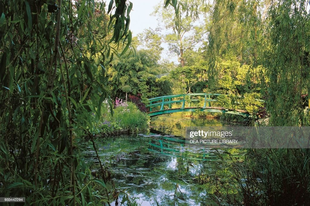 Wooden Bridge Over The Lily Pond In The Garden Of The House Of Claude Monet  Giverny
