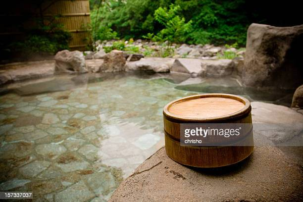 wooden bucket by a japanese hot spring bath - hot spring stock pictures, royalty-free photos & images