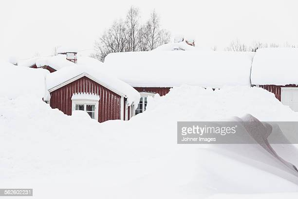 wooden buildings covered in snow - deep snow stock pictures, royalty-free photos & images