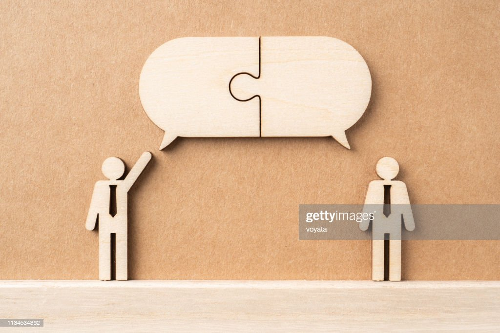 wooden businessman with conversation concept : Stock Photo