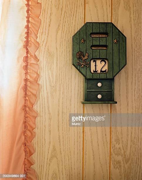 Wooden calendar on wall, close-up