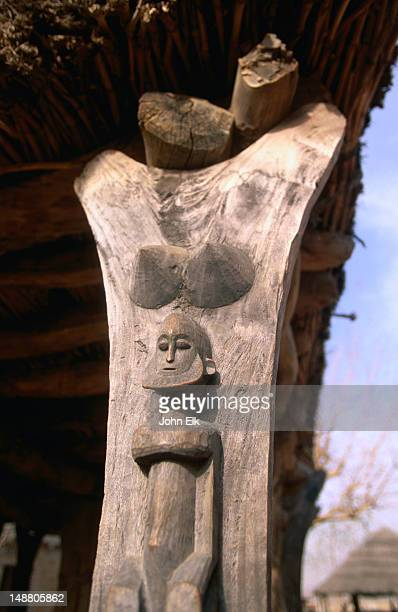 A wooden carved totem in a 'toguna' hut, the ceremonial shelter where men only meet to sit, discuss, relax, drink beer and look at suggestive totems.