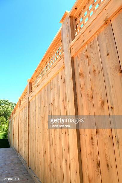 wooden cedar fence - fence stock pictures, royalty-free photos & images