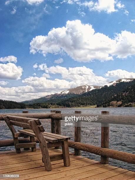 Wooden chair near lake