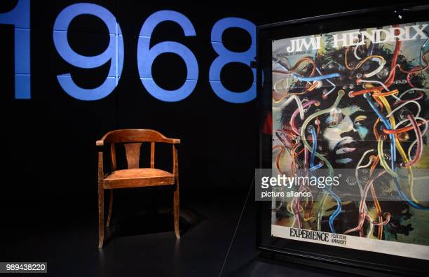 A wooden chair on which Jimi Hendrix supposedly sat on in 1969 is exposed next to a poster of himas the Medusa of cables by Guenther Kieser in the...