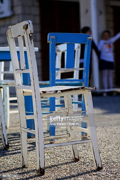 Wooden Chairs On Sidewalk Cafe
