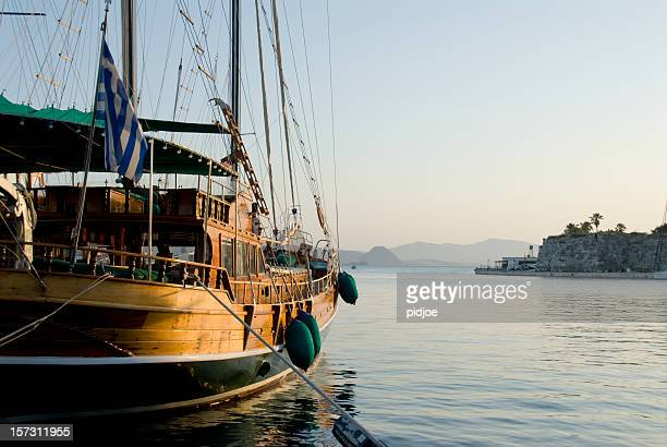 wooden charter sailing boat in Kos Harbor at dawn