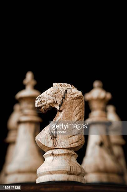 wooden chess knight and pieces - ogphoto stock pictures, royalty-free photos & images