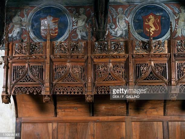 Wooden choir stalls in the chamber of Marguerite of Foix Casa Cavassa Saluzzo Piedmont Italy