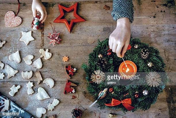 wooden christmas table with hand lighting Advent wreath