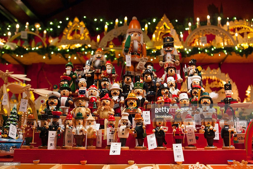 Wooden Christmas tree decorations sit on display at a market in Berlin, Germany, on Sunday, Dec. 1, 2013. Euro-area economic growth slowed to 0.1 percent in the third quarter after a 0.3 percent gain in the previous three months. Photographer: Krisztian Bocsi/Bloomberg via Getty Images