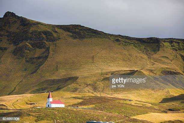 wooden church framed against the westfjord hills - westfjords iceland stock photos and pictures