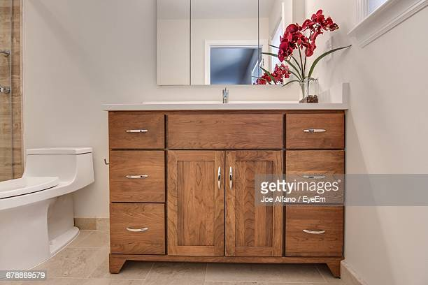 wooden closed cabinet in bathroom - medicine cabinet stock pictures, royalty-free photos & images