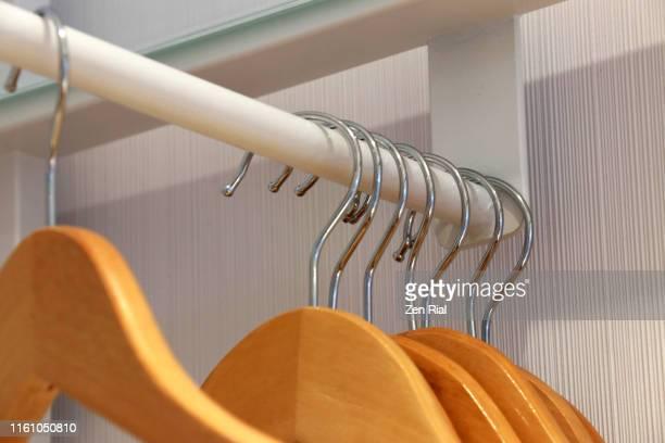 Wooden closet hangers in a hotel room