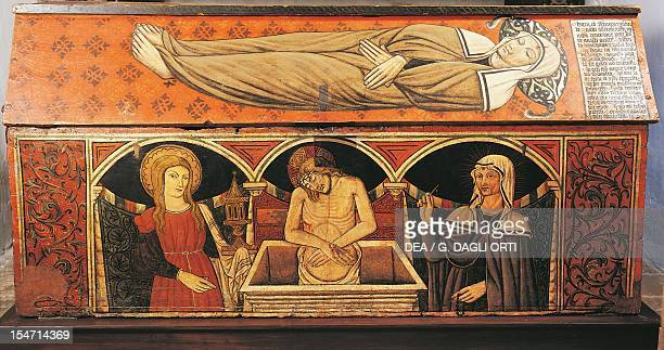 Wooden coffin with the image of Santa Rita in an Augustinian habit lying in the sleep of death on a star patterned cloth by Antonio da Norcia Convent...