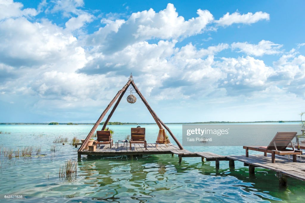 Wooden construction, floating terrace in Bacalar, Mexico's Mayan Riviera, Quintana Roo, Mexico : Stock Photo