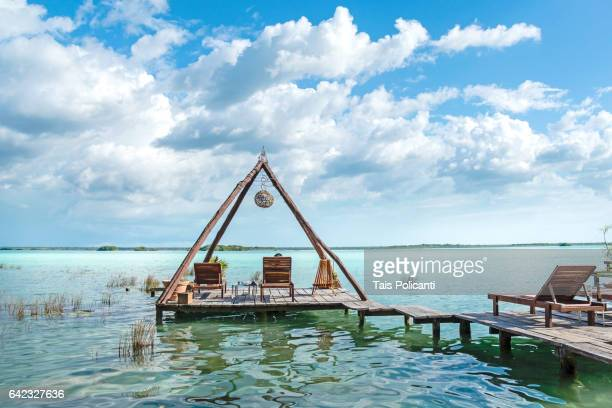wooden construction, floating terrace in bacalar, mexico's mayan riviera, quintana roo, mexico - mayan riviera stock photos and pictures