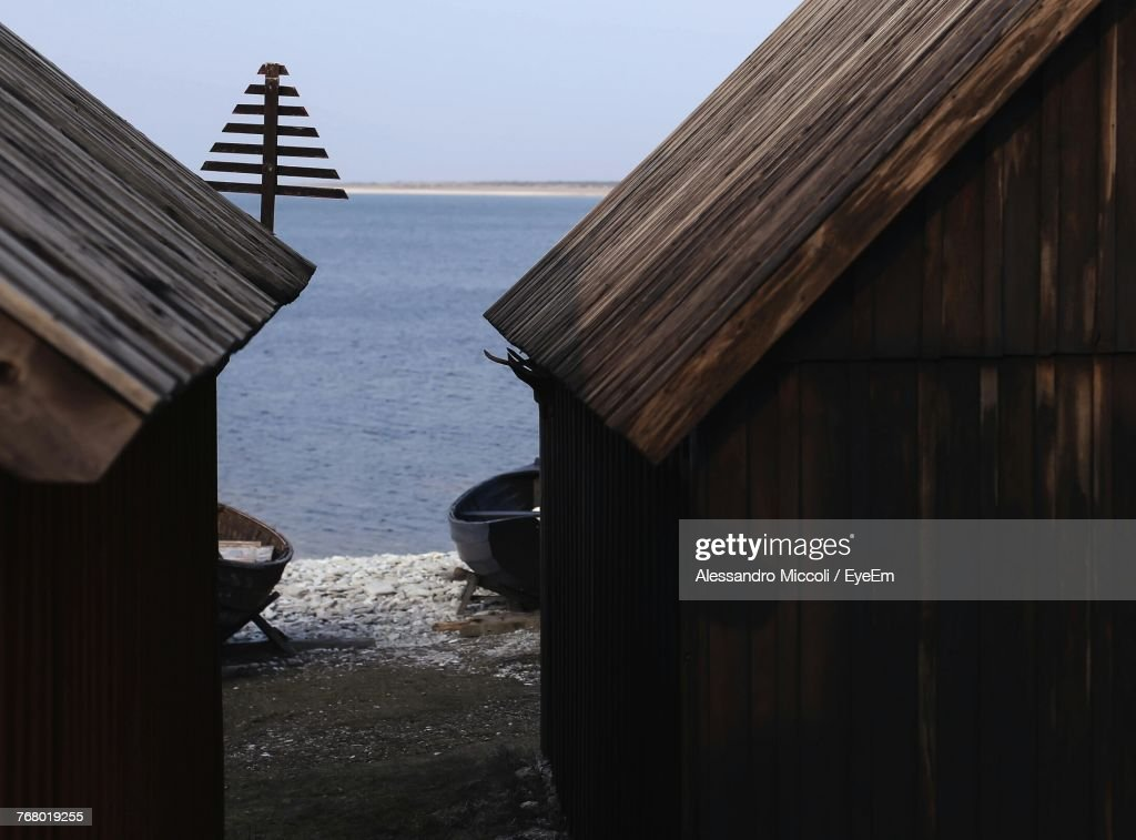 Wooden Cottages At Beach Against Sky : Stock Photo