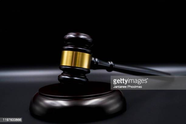 wooden court gavel on black background. symbol of justice, judge and trial.  auction. law and justice, legality concept, judge. - hammer stock-fotos und bilder