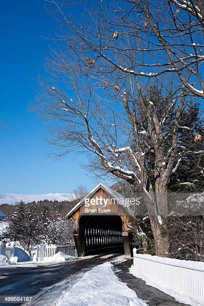 Wooden covered bridge in the snow Woodstock VT