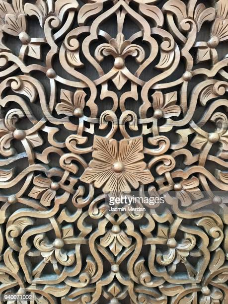 wooden craft floral pattern background - relief carving stock pictures, royalty-free photos & images