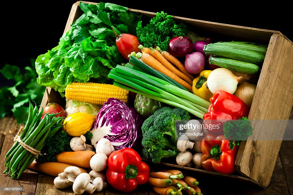 Wooden crate filled with fresh organic vegetables : Stock Photo
