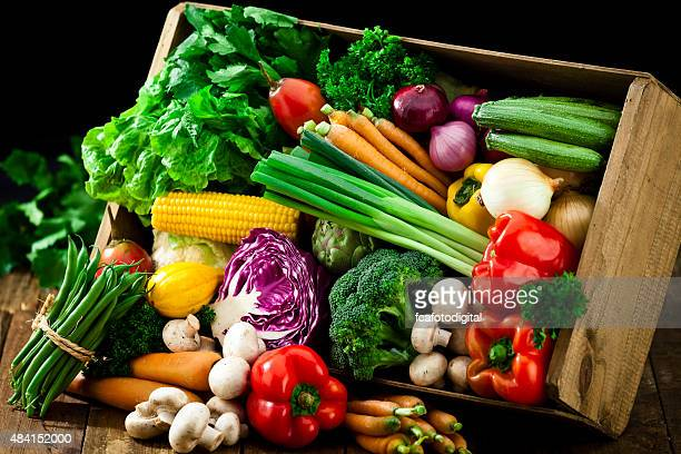 wooden crate filled with fresh organic vegetables - vegetable stock pictures, royalty-free photos & images