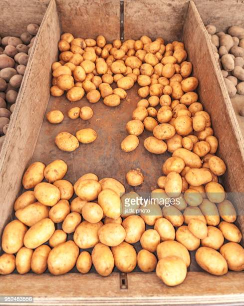 wooden crate full of potatoes