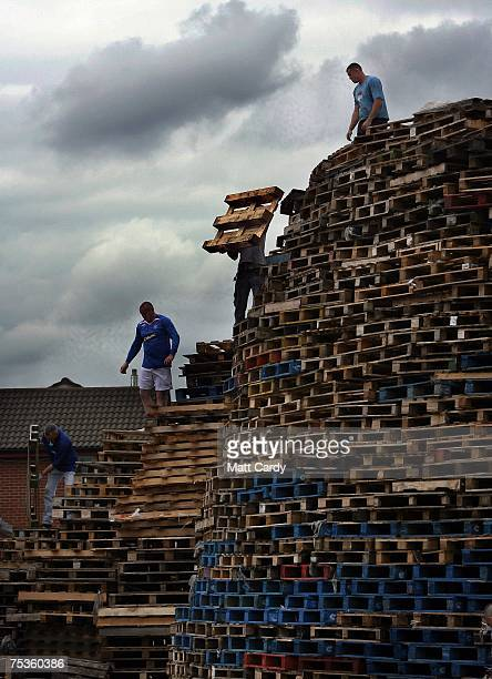 Wooden crates are stacked as people build a bonfire on the Shankill Road on July 11 in Belfast Northern Ireland The bonfires which are seen by the...