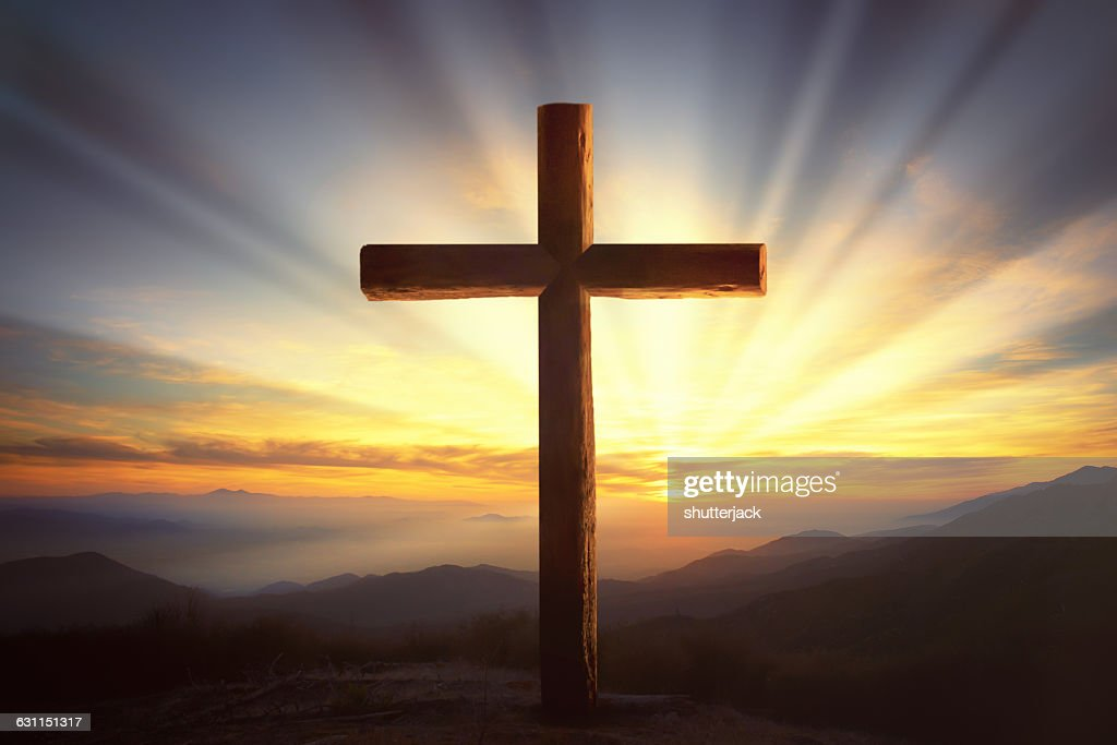 Wooden Cross on a Hill at sunset : Stock Photo