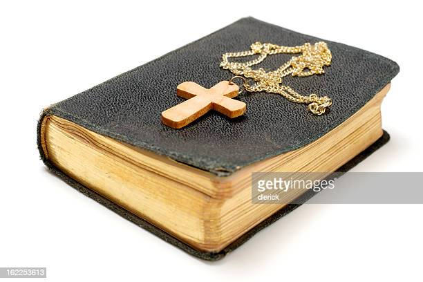 Wooden Cross on Old Bible
